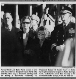 Maj Gen Guy C Swain III escorting Betty Ford at funeral of Gerald Ford-2006