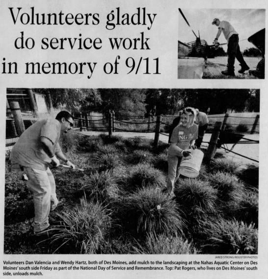 Volunteers gladly do service work in memory of 9/11 - Volunteers gladly no sprvinp work in memory of...