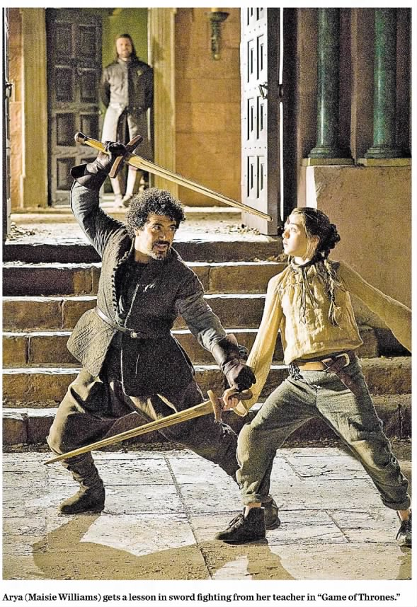 Arya learning to fight, photo from 2011 review of the Game of Thrones TV debut