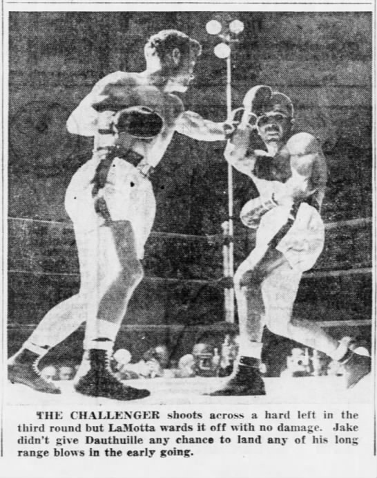 Pictured: Jake Lamotta and Dauthuille in action. - THE CHALLENGER shoots across a hard left in the...