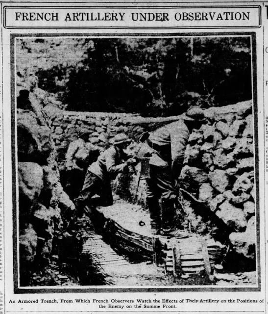 Picture of French soldiers observing effects of their artillery from armored trench at the Somme -