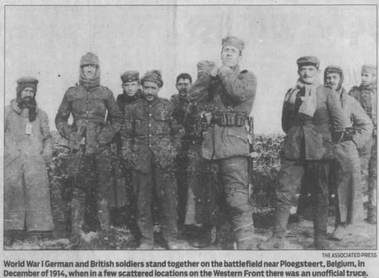 World War I German and British soldiers stand together during the 1914 Christmas Truce -