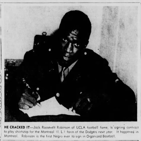 Photo of Jackie Robinson signing with the Montreal Royals in 1945 -