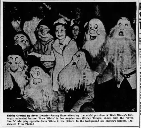 "Shirley Temple greet by the Seven Dwarfs at Hollywood premiere of ""Snow White"" -"