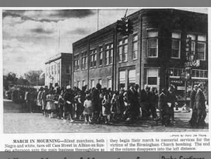 An image of a silent march being held in Michigan for the victims of the Birmingham Church Bombing