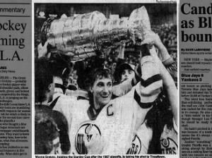 Wayne Gretzky of the Edmonton Oilers hoists the Stanley Cup following victory in the 1987 playoffs