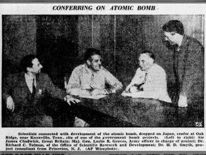 Picture of scientists conferring about the development of the atomic bomb