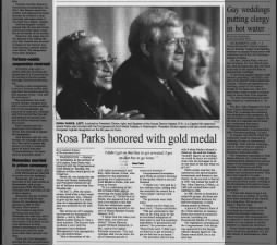 Photo and article about Rosa Parks being awarded the Congressional Gold Medal in 1999