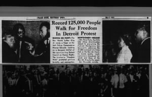 Photo of Rosa Parks addressing a crowd in 1963 during a protest in Detroit